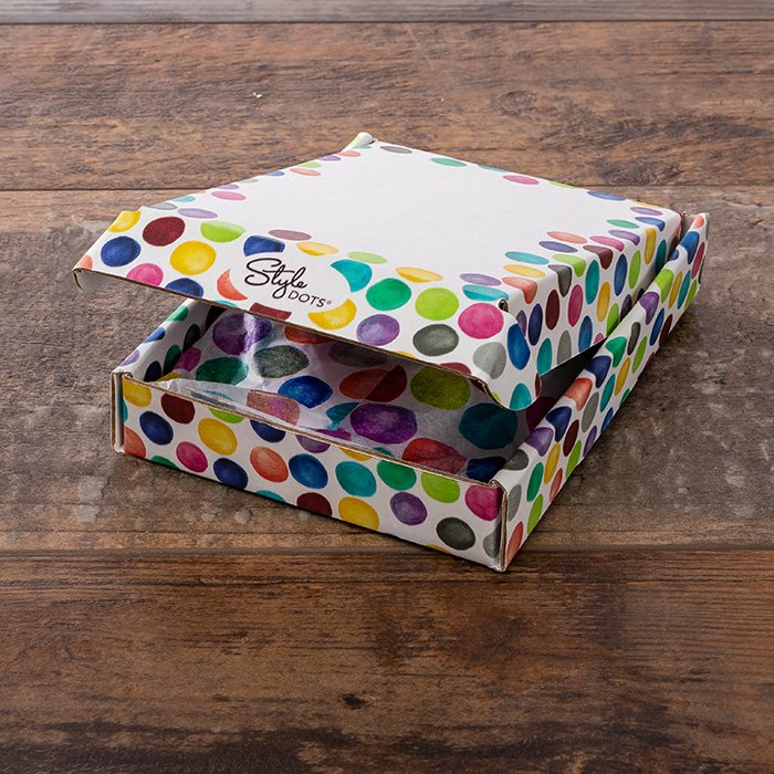 Polka dotted packaging for Dot Club by Style Dots.